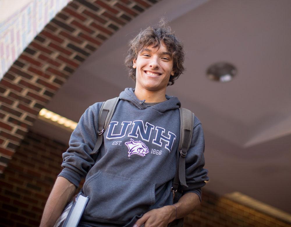 student posing in doorway on campus