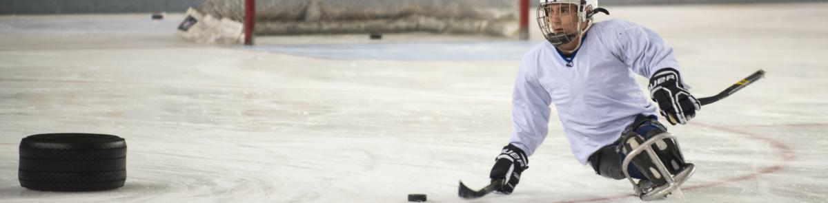Student playing sled hockey