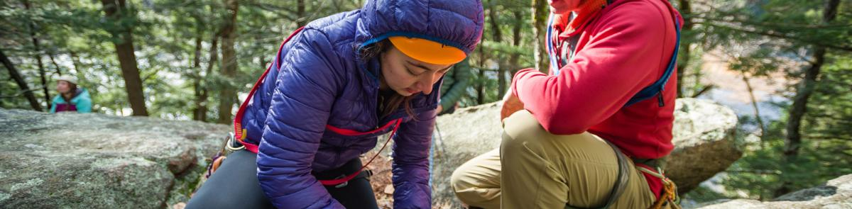 UNH students practicing tying ropes for rock climbing