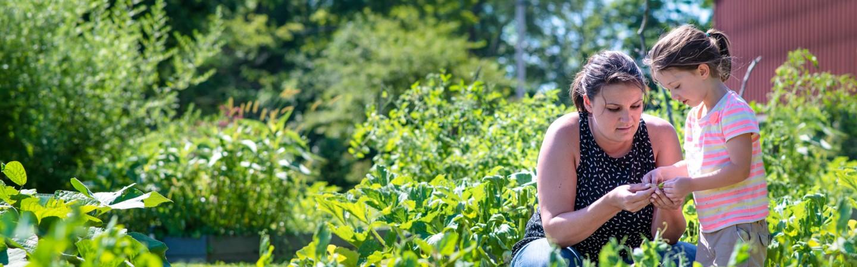 child and teacher in outdoor garden