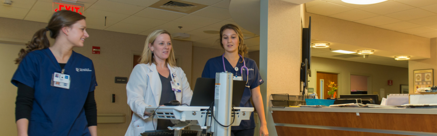 Nursing students working in a hospital setting