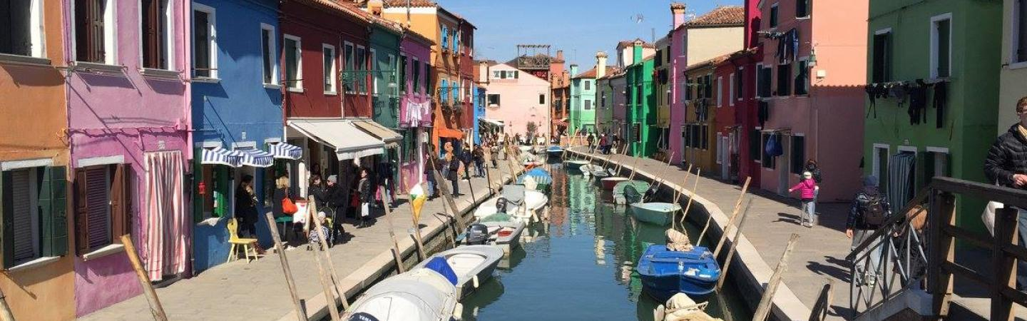 chhs study abroad colorful homes along canal in italy