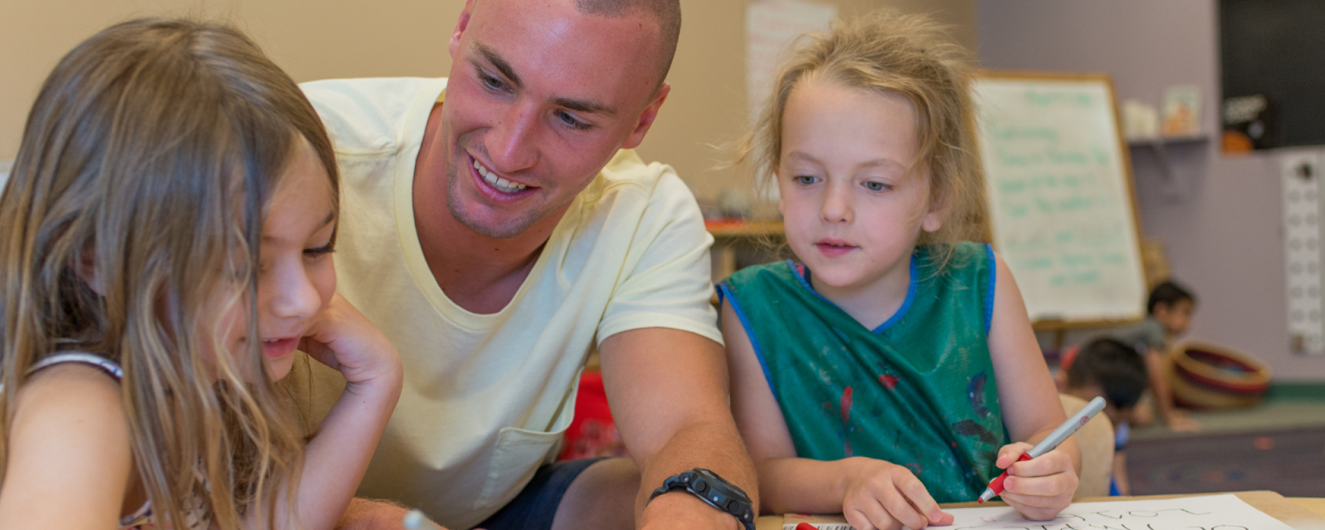 Student working with children at the Child Study and Development Center
