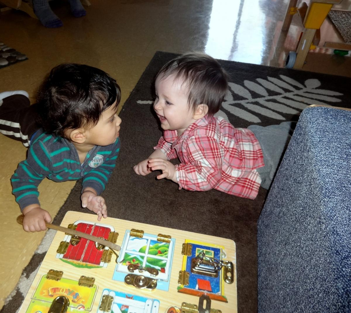 two infants playing in classroom