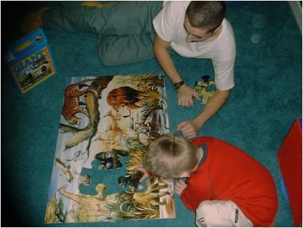 father and son doing a puzzle