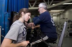 Kinesiology student monitoring man's cardiac test