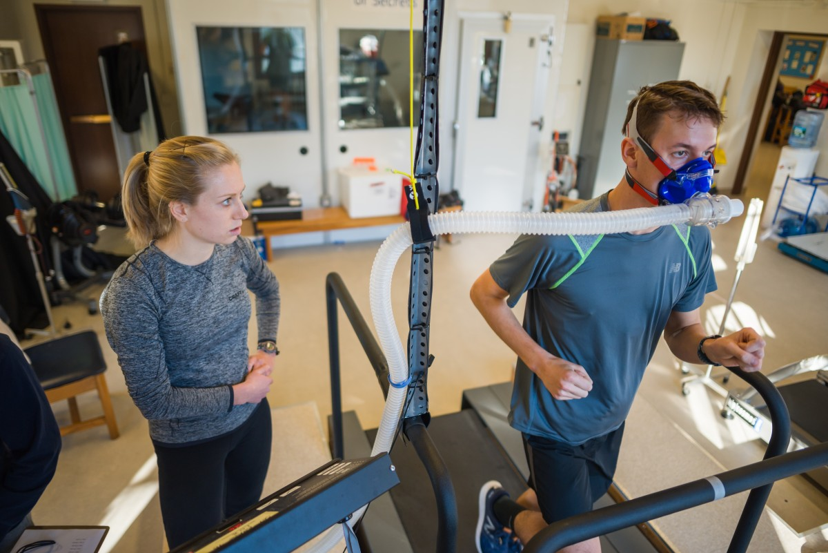 Faculty member and student doing an exercise test on another student in the exercise physiology laboratory