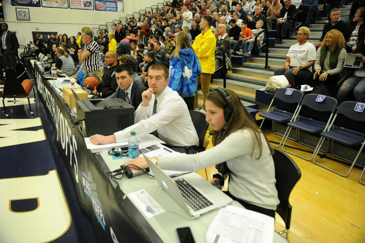 Students recording basketball game